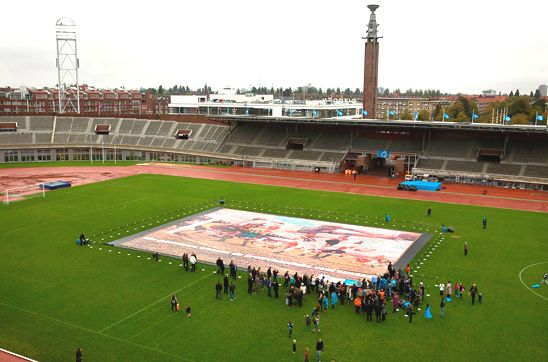 A huge jigsaw mosaic depicting top-flight Dutch footballers in a stadium in Amsterdam